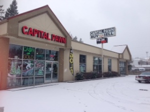 Our beautiful building today on December 6, 2013 with the snow--we are OPEN even at 26 degrees :) Happy National Pawnbrokers' Day!