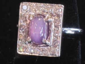 C) Rectangle 14k white gold ring. Diamonds and purple stone. Size: