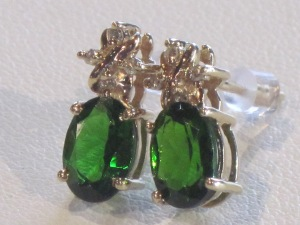 A) Emerald-like earrings with diamonds set in 14k yellow gold.