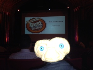 The announcement runs across the big screen as E.T. takes a selfie.