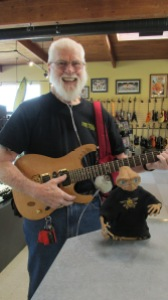 A customer, who is a fan of Capital Pawn, shows off his new purchase. We, at Capital Pawn, are big fans of his!!