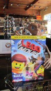 E.T. holds The Lego Movie on the counter at Capital Pawn